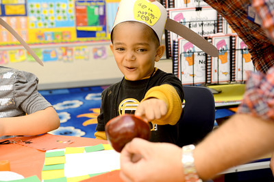 Danville Elementary kindergarten student Seth Hahn points at an apple during a craft project on Wednesday as Mrs. June Heeter's kindergarten class celebrated Johnny Appleseed Day.