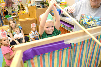 Zachary Jarrett fishes for a prize in June Heeter's kindergarten class on Wednesday at the Danville Primary Center as they celebrated Johnny Appleseed Day.
