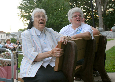 Sister Maria Goretti, left, and Sister Jean Gallagher both of Danville sing along with KJ Wagner during a free concert sponsored by Montour Area Recreation Commission Tuesday evening July 24, 2011 at Memoiral Park in Danville.