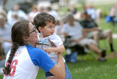 Katie Reidinger and her son, Oliver, 2, move toward the stage to listen to KJ Wagner during a free concert sponsored by Montour Area Recreation Commission Tuesday evening July 24, 2011 at Memoiral Park in Danville.