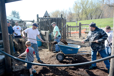 Volunteers came together on Sunday morning to help fix up the Kidsville playground in Danville.