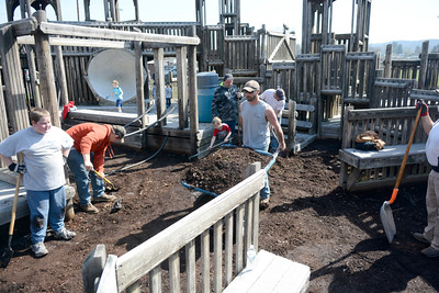 A host of volunteers came together on Sunday morning to help fix up the Kidsville playground in Danville.