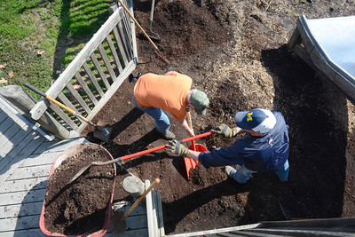 Pete Rickert, left, Danville, and Matt Hickey, Danville, help to fix up the Kidsville playground on Sunday in Danville.