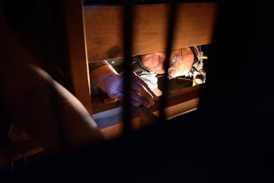 Gary Nace focuses on repairing the organ at the Mahoning Presbyterian Church in Danville on Thursday morning.