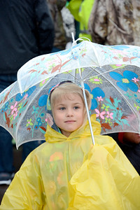 Gemma Smolenak, 6, Nescopeck, tries to stray dry during the March of Dimes walk on Sunday at Geisinger in Danville.