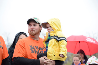 Aaron Snyder of Pittman holds his son Mason, 3, who was helped by the March of Dimes after he was born with health complications, during the annual March of Dimes walk at Geisinger in Danville on Sunday.