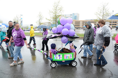 Amanda Holmes of Hughesville pulls a wagon with her children Kiptyn, 2, left, and Kinsley, 4, right, during the annual March of Dimes walk at Geisinger on Sunday. Kinsley was born prematurely weighing only two pounds nine ounces.