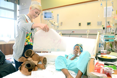 Miss Teen PA Sydney Robertson, 16, left, Williamsport, looks at a picture made by Luvly Davis McGraw, 9, Scranton, while visiting her at the Janet Weis Children's Hospital in Danville on Wednesday.