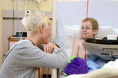 Miss Teen PA Sydney Robertson, 16, left, Williamsport, talks with Gabriel Carpenter, 6, Wellsboro, while visitng him in the Janet Weis Children's Hospital on Wednesday in Danville.