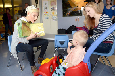 Miss Teen PA Sydney Robertson, 16, left, Williamsport, reads a story to Auron Benson, 2, and his mother Rachael Brink, Athens, while they are staying at the Janet Weis Children's Hospital on Wednesday.