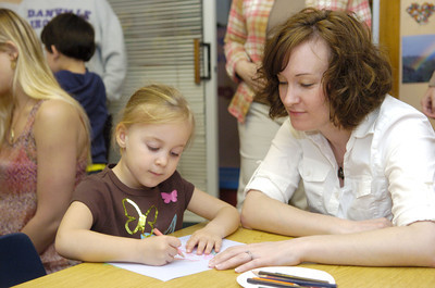 Sophia Johns, 4 and her mother Heather Johns, color a picture together on Thursday at a mommy and me day at Lutz Day Care in Danville.