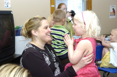 Holly Schrader smiles as her daughter Natalie, 4, sings a song to her with her class at Lutz Day Care in Danville for a mommy and me day on Thursday.