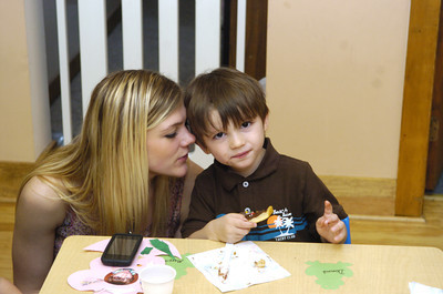 Chelsie Derr and her son Dominik, 3, make a cookie together on Thursday at a mommy and me day at Lutz Day Care in Danville.