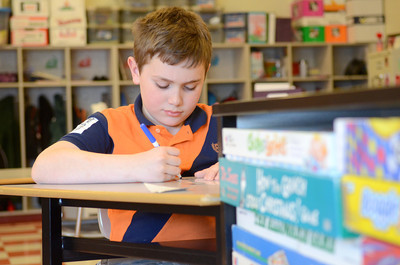 Liberty Valley Intermediate School student Jacob Lowry, 9, does math problems in his class on Wednesday.