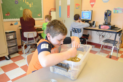 Liberty Valley Intermediate School student Jacob Lowry, 9, takes a break from his lesson work in class on Wedensday.