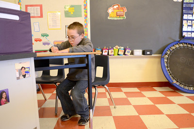 Liberty Valley Intermediate School student Kaden Triebley writes a letter to a classmate during his class lesson on Wednesday.