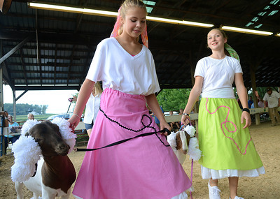 Anna Buck, 13, left, of Washingtonville and Carly Britch, 11 of New Media guide their goats around the arena during the Pet and Toy Parade Wednesday Aug 15, 2012 at the Montour-Delong Fair in Washingtonville.