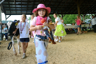 Cowgirl, Kyra McCormick, 6, of Danville and her toy partners, Jessie and Woody, lead off the Pet and Toy Parade Wednesday Aug 15, 2012 at the Montour-Delong Fair in Washingtonville.