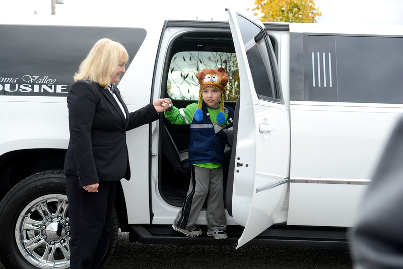 Danville kindergarten student Nathan Klein hops out of a Susquehanna Valley Limousine on Thursday morning outside Pumpkinville in Riverside as kids who did well in a school fundraiser were treated to the trip.