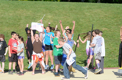 Fifth grade students and members of the Raven Claw house at Liberty Valley Intermediate celebrate their house's win during a variation of the Muggle Quidditch Cup championship as they finished up a lesson on Harry Potter.