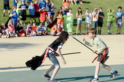 Liberty Valley Intermediate fifth grade students Jennah Reibsome and Brandon Welliver try to get each others belts while playing a variation of Muggle Quidditch to cap off a lesson using Harry Potter.