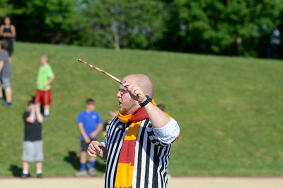 Liberty Valley Intermediate teacher Guy Moses acts as a referee for the fifth grade students participating in a version of Muggle Quidditch on Wednesday as the students finished a lesson on Harry Potter.