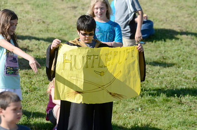 Owen Smith cheers on his house team Hufflepuff as they competed in a variation of the Muggle Quidditch Cup at the Liberty Valley Intermediate School as fifth grade students completed a lesson on Harry Potter.