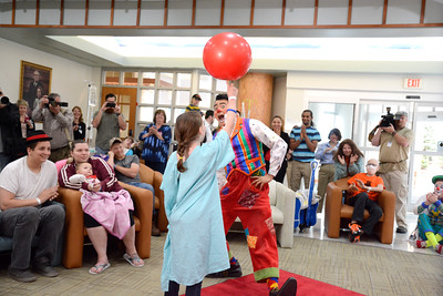 Ava Patrisso, 9, helps Ivan Skinfill of Clown Alley with the Ringling Brother's Circus perform a trick for a crowd at the Janet Weis Children's Hospital in Danville.