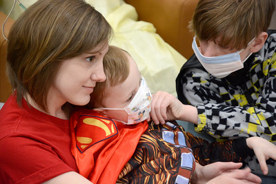 Christine Dalton, Mansfield, holds her son Elijah, 5, in her lap while his brother Aidan, 11, checks in on him as they watch the Ringling Brothers Circus perform at the Janet Weis Children's Hospital in Danville.