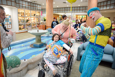 Isabella Muller, 8, of Swoyersville, and her mother Jessica, talk with Nick Lambert, after his performance with the Ringling Brother's Circus at the Janet Weis Children's Hospital in Danville.