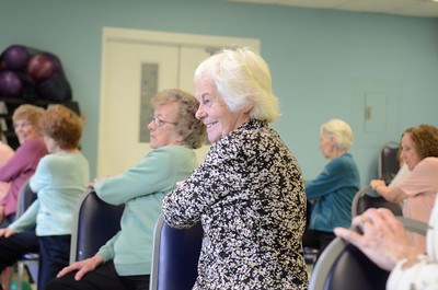Dottie Grimm of Mayberry Township smiles while exercising during a Silver Sneakers class at the Danville Area Community Center on Wednesday.