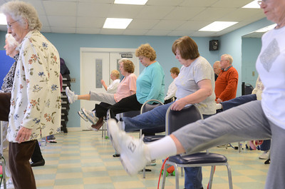 Seniors participate in a Silver Sneakers exercise class at the Danville Area Community Center on Wednesday.