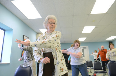 Eleanor Fahringer, Danville, exercises at a Silver Sneakers class at the Danville Area Community Center on Wednesday.
