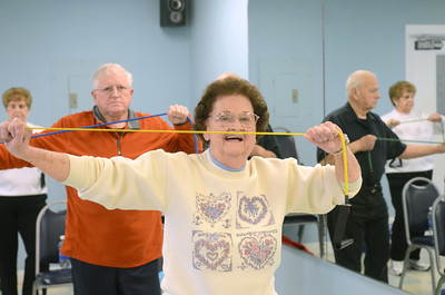 Arlene Maurer, Elysburg, uses a exercise band during a Silver Sneakers class for seniors at the Danville Area Community Center on Wednesday.