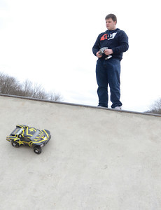 Ian Maize, 19 Riverside, drives a remote control car at the skate park inside Hess Recreation Area on Sunday.