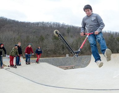 Jared Huntington, 15 Danville, does tricks on his scooter at the Hess Recreation Area on Sunday.