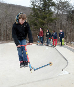Trystin Gearhart, 15 Danville, does tricks on his scooter at the Hess Recreation Area on Sunday afternoon.