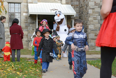 Anna and Olaf walk along with students from St. Cyril's in Danville during their Halloween parade on Friday.
