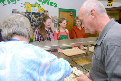 Volunteers at St. Joe's annual Thanksgiving dinner in Danville dish out and deliver food to eager diners on Thursday.