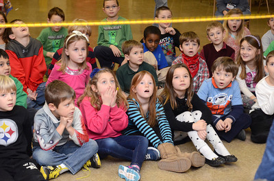 St. Joseph students in Danville react during a program on dinosaurs put on by the Academy of Natural Sciences of Drexel University on Tuesday.
