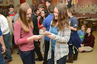 St. Joseph students in Danville, Makenna Luzenski, 12, left, and Alexa Willoughby,14 , match up their items during a program on rocks and minerals on Tuesday put on by the Academy of Natural Sciences of Drexel Universty.
