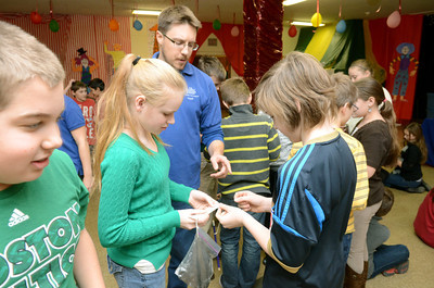 St. Joseph students in Danville, Breyann Johnson, 11, left, and Ashby Bodine, 10, match up their items with the help of Mike Kaczmarczik of the Acadamey of Natural Sciences of Drexel University during a program on rocks and minerals on Tuesday.