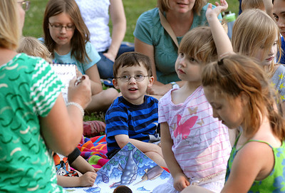 Eitan Babich, 3, center, of Danville helps list thing that can be found at the beach during Grove Presbyterian Church's story hour Wednesday June 13, 2012 at Memorial Park in Danville.  Angie Gibson led the event which included books and activities all about the beach and ocean.