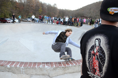 Pro skateboarder Drew Dezort rides along the edge of a wall at the Danville Skate Park on Tuesday afternoon as the Vox pro skate team showed off their talents to a crow of around 100 people.