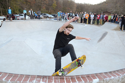 Pro skater Shaun Gregoire does a trick on a wall at the Danville Skate Park on Tuesday afternoon in front of a large crowd.