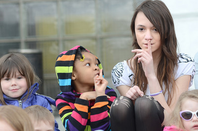 DCDC student Tina Archer, 5, left, and Danville Middle School 8th grade student Julia Porter go through a song motions with others during a Week Of The Young Child celebration on Tuesday at the Montour County Courthouse.