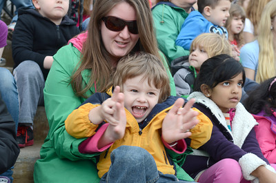 DCDC student Lleyton Brokenshire, 3, sits and sings with Amanda Bastian on the steps of the Montour County Courthouse Tuesday morning for a celbration of The Week Of The Young Child.