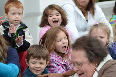 DCDC students Lily Gavin, 4, top, and Millie Nichols, 5, bottom, sing during a Week of The Young Child event on Tuesday on the steps of the Montour County Courthouse.