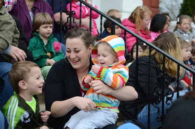 Connor Reedy, 3, left, sings The Wheels On The Bus with Lauren Reedy, and Charli Bartholomew, 2, all of Stepping Stones Child Care in Danville, on Tuesday morning at the Montour County Courthouse for a Week of The Young Child event.