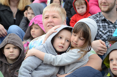 Tammy Kashner of Trinity Child Care helps keep students Cooper Mankoski, 4, and Harper Burkhart, 4, warm as they sit on the steps of the Montour County Courthouse on Tuesday morning during a event for The Week of the Young Child.